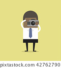 African businessman takes a picture with camera. 42762790