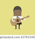 African businessman playing guitar. 42763348