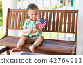 Mixed Race Chinese Caucasian Boy Plays With a Flag 42764913