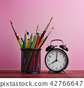 Alarm Clock and School Stationary in Basket 42766647