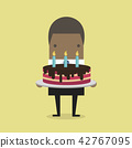 African businessman with a big cake. 42767095