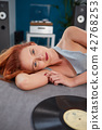 the image of resting sexy woman listening to vinyl 42768253
