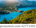 Panoramic view to Assos village Kefalonia. Greece. White lonely yacht in beautiful turquoise colored 42771465