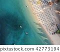 Aerial view of bright turqoise water and beach 42773194