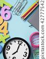 school supplies and clock at seven 42777542