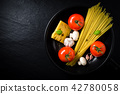 Spaghetti ingredients in black frying pan 42780058