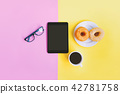 Modern office workplace, tablet, donuts and coffee 42781758