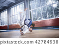 Two judo fighters showing technical skill while practicing martial arts in a fight club 42784938