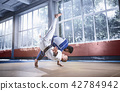 Two judo fighters showing technical skill while practicing martial arts in a fight club 42784942
