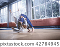 Two judo fighters showing technical skill while practicing martial arts in a fight club 42784945