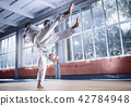 Two judo fighters showing technical skill while practicing martial arts in a fight club 42784948