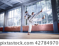 Two judo fighters showing technical skill while practicing martial arts in a fight club 42784970