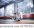 Two judo fighters showing technical skill while practicing martial arts in a fight club 42785001