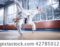 Two judo fighters showing technical skill while practicing martial arts in a fight club 42785012