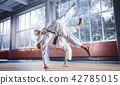 Two judo fighters showing technical skill while practicing martial arts in a fight club 42785015