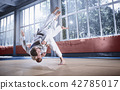 Two judo fighters showing technical skill while practicing martial arts in a fight club 42785017