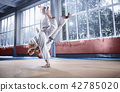 Two judo fighters showing technical skill while practicing martial arts in a fight club 42785020