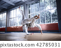 Two judo fighters showing technical skill while practicing martial arts in a fight club 42785031