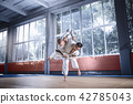 Two judo fighters showing technical skill while practicing martial arts in a fight club 42785043