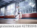 Two judo fighters showing technical skill while practicing martial arts in a fight club 42785046