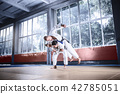 Two judo fighters showing technical skill while practicing martial arts in a fight club 42785051