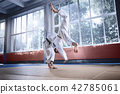 Two judo fighters showing technical skill while practicing martial arts in a fight club 42785061