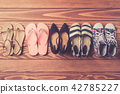 Female shoes collection on wooden background 42785227
