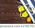 Beach accessories on white wooden table. 42785781