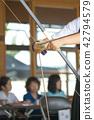Kyudo member shooting arrow 42794579