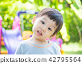 Little asian boy smiling at school playground 42795564