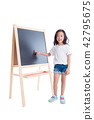 girl standing and point at blackboard over white  42795675
