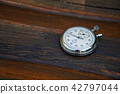 Sport watch on bench made of wood 42797044