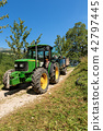 Tractor with Trailer on the Italian Alps 42797445