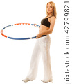 sporty fit girl doing exercise with hula hoop. 42799821