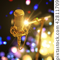 Gold Microphone On Beautiful Abstract Colored Background 42811709