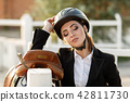 elegant rider woman in helmet with whip 42811730