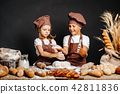 Adorable girl with brother cooking 42811836
