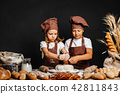 Adorable girl with brother cooking 42811843