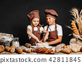 Adorable girl with brother cooking 42811845