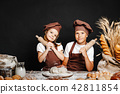 Adorable girl with brother cooking 42811854