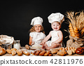 Adorable girl with child on table cooking 42811976