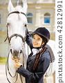 Smiling female rider wearing white shirt and dark jacket 42812991