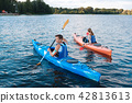 Strong athletic man participating in kayaking competition 42813613