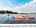Man and woman meeting each other while kayaking on summer day 42813618