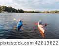 Loving couple kayaking on nice warm summer day 42813622