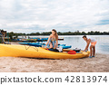Cute loving couple getting ready for memorable river adventure 42813974