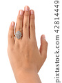 Ring in hand woman isolate on white background. 42814449