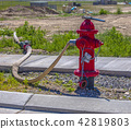 Hose trailing off from fire hydrant 42819803