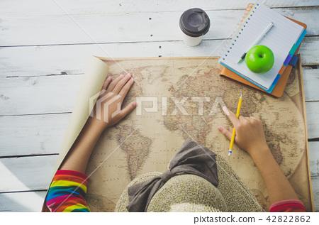 Traveler finding location for travel on  world map 42822862