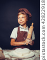 cute little boy with chef hat cooking 42822918